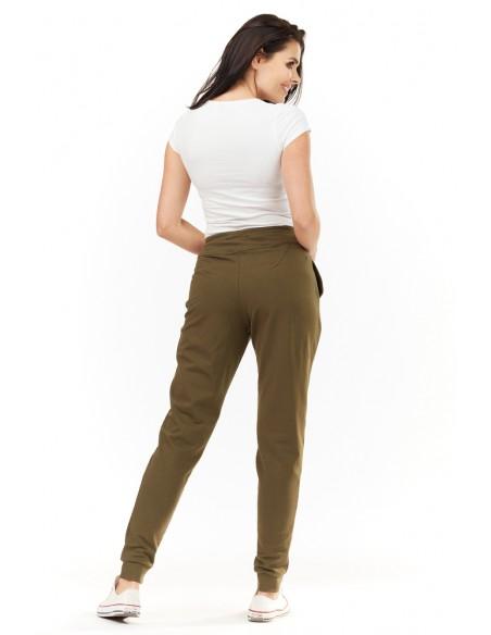 Dresowe spodnie damskie z kieszeniami - oliwkowe