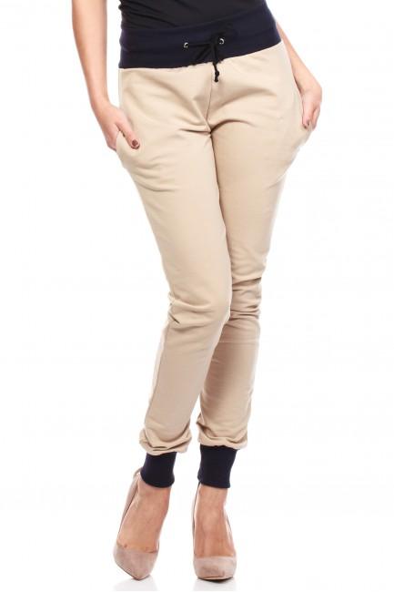 Dresowe spodnie damskie ze ściągaczami - beżowe